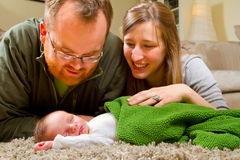 Happy Mother and Father With Newborn Stock Images