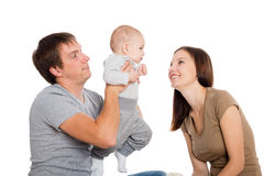 Happy mother and father playing with his son. Happy mother and father playing with his young son. Child seven months stock image