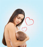 Happy mother feeding her adorable baby Royalty Free Stock Image