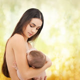 Happy mother feeding her adorable baby Royalty Free Stock Images