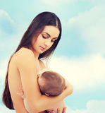 Happy mother feeding her adorable baby Stock Photography