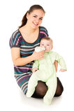 Happy the mother feeds her baby Royalty Free Stock Photo