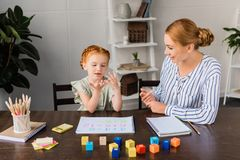 Mother and daughter learning math at home Royalty Free Stock Photography