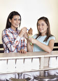 Happy Mother And Girl Having Chocolate Ice Cream At Counter Royalty Free Stock Photography
