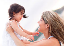 Mother and girl outdoors Stock Photo