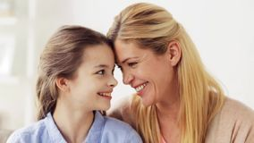 Happy mother and girl looking at each other stock video