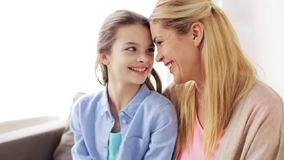 Happy mother and girl looking at each other stock footage