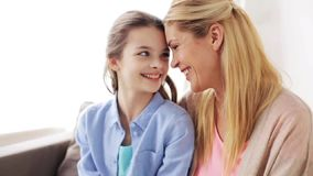 Happy mother and girl looking at each other stock video footage