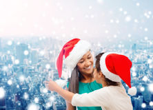 Happy mother and girl in santa hats Stock Photo
