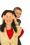 Happy mother give piggy back to son Stock Images