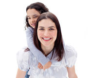 Happy mother giving her daughter piggyback ride Royalty Free Stock Photography