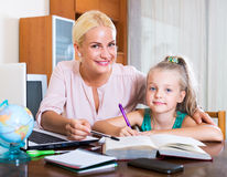 Happy mother helping little daughter Stock Photo