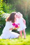 Happy mother and her adorable daughter in garden Stock Photography
