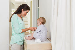 Happy mother with her baby boy Stock Photography