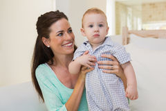 Happy mother with her baby boy Stock Photos