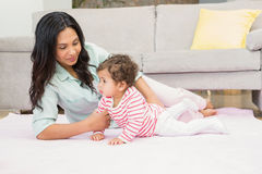 Happy mother with her baby daughter stock images