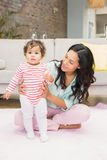 Happy mother with her baby daughter Stock Photo