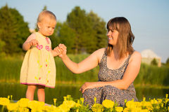 Happy Mother and her Baby Daughter Stock Images