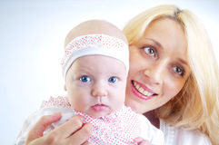 Happy mother and her baby girl stock image