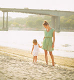 Happy mother with her baby girl at beach at summer Royalty Free Stock Photo