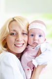 Happy mother and her baby girl Royalty Free Stock Images