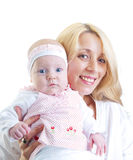 Happy mother and her baby girl Stock Photos