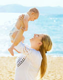 Happy mother and her baby son on the beach Royalty Free Stock Photo