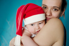 Happy mother with her baby. Happy young mother with her sweet baby Royalty Free Stock Photos