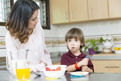 Happy Mother and her boy having breakfast Royalty Free Stock Photo