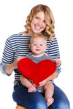 Happy mother and her child holding a red heart Royalty Free Stock Photo