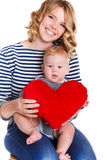 Happy mother and her child holding a red heart Royalty Free Stock Photos
