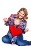 Happy mother and her child holding a red heart Stock Photos