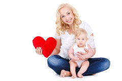Happy mother and her child holding a red heart Stock Photo