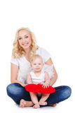 Happy mother and her child holding a red heart Royalty Free Stock Images