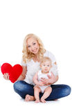 Happy mother and her child holding a red heart Stock Images