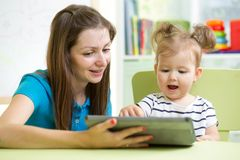 Happy mother and her child with tablet pc Royalty Free Stock Photography