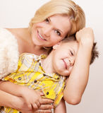 Happy mother with her child together on a white Stock Photo