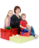 Happy mother with her children on the background Royalty Free Stock Image