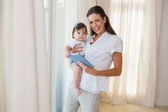 Happy mother with her cute baby girl using tablet Royalty Free Stock Images