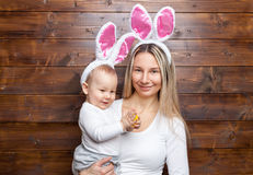Happy mother and her cute child wearing bunny ears, getting ready for Easter Royalty Free Stock Photography