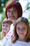 Happy mother and her cute daughters outdoors Royalty Free Stock Photography