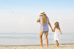 Happy mother and her daughter on beach. Royalty Free Stock Images