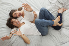 Happy Mother with her daughter on the bed Royalty Free Stock Image