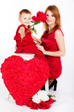 Happy mother and her daughter with big red heart Royalty Free Stock Photos