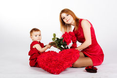 Happy mother and her daughter with big red heart Stock Image