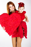 Happy mother and her daughter with big red heart Stock Photo