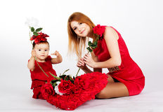 Happy mother and her daughter with big red heart Royalty Free Stock Images