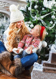 Happy mother and her daughter with Christmas gifts Royalty Free Stock Image