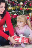 Happy mother and her daughter with Christmas presents Stock Photography