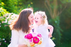 Happy mother and her daughter in the garden Stock Photos